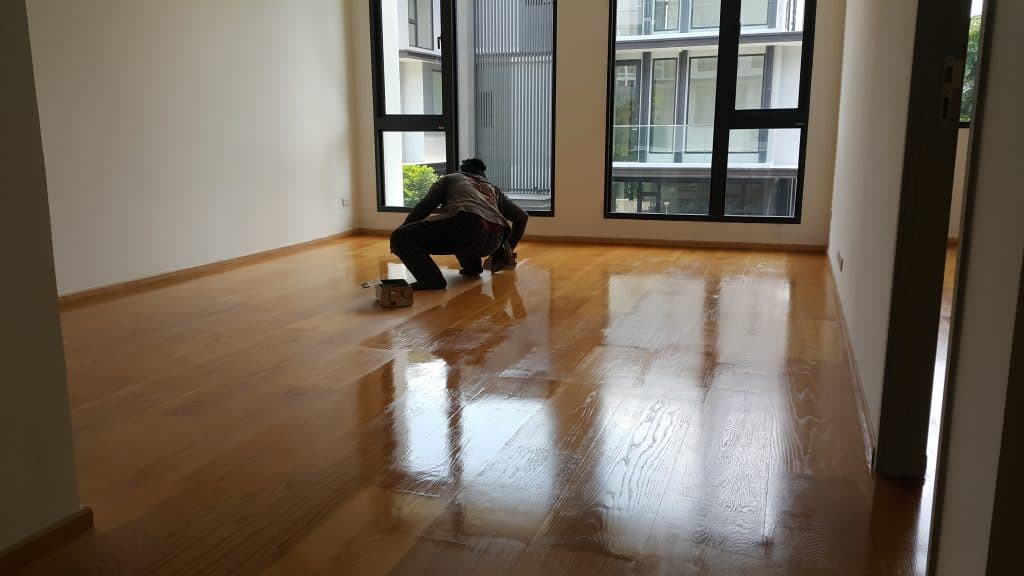 Polyurethane finish being applied to a wood floor.