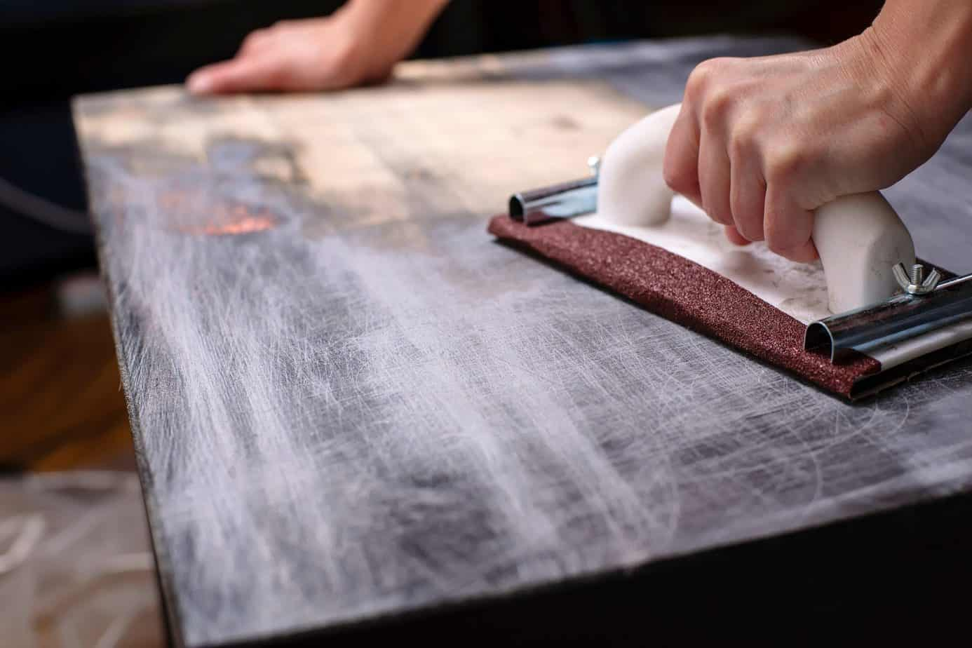 Sanding a Surface to Refinish Furniture