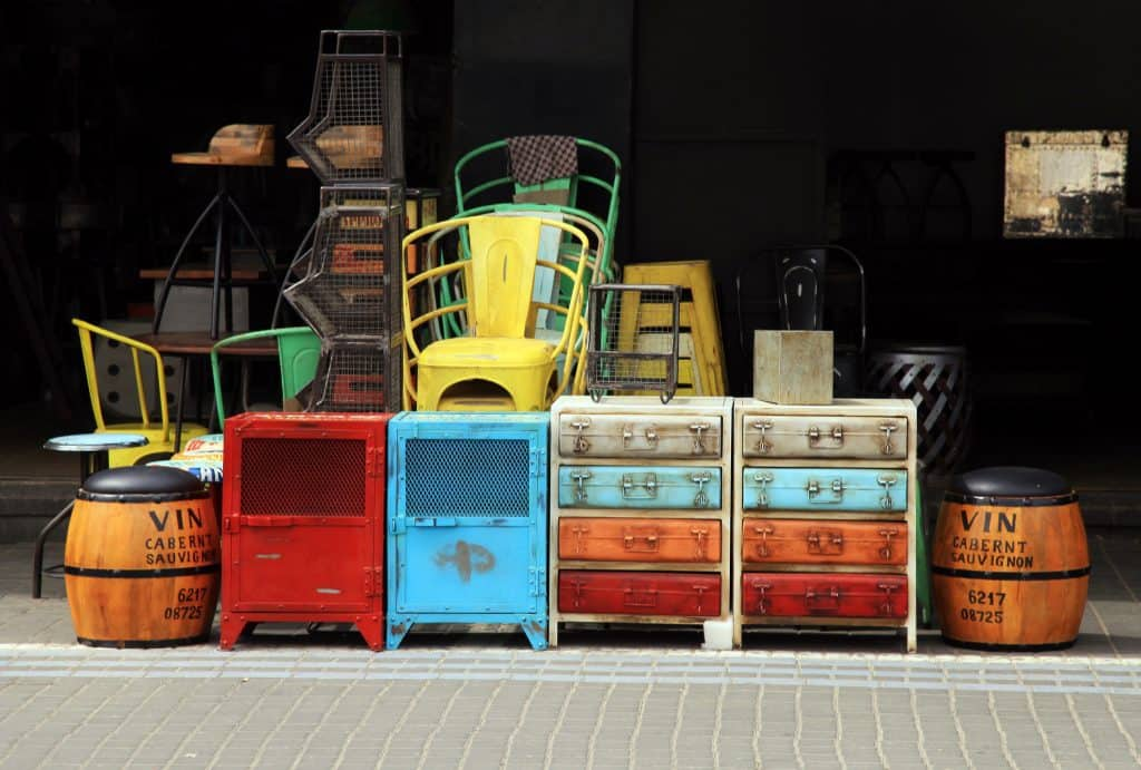 Flip furniture for profit - furniture set out front to sell.
