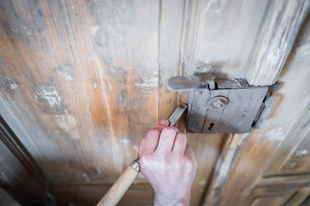 Refinishing a door.